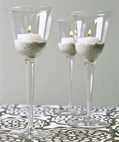 wine glasses as candle holders to lift them up...