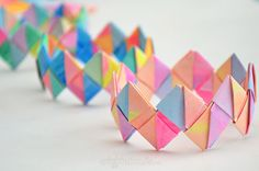Make a cool folded paper bracelet using recycled water colour paintings. These make a great mother's day gift, or a perfect tween party activity.