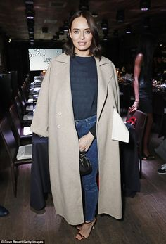 Stylish: Laura put on a casual display in skinny jeans and a slogan jumper as she attended...