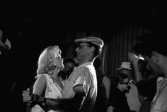 """Before Marilyn and Montgomery Clift film a dance scene in """"The Misfits"""", Arthur Miller shows Marilyn how his father used to dance. Photo by Eve Arnold, 1960"""