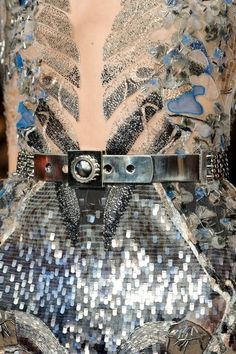 Decorative garment details: dress with sequin & seed bead embelished patterns + industrial silver belt