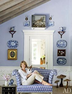 Blue and white beach house in Boca Grande, Florida. Nancy Morton, designer and owner, pictured with her dog Rupert.