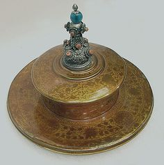 Monk's Hat; Date: 18th century; Culture: Tibet; Medium: Lacquer with finial of silver, coral and blue glass; Dimensions: H. 9 13/16 in. (25 cm); Diam. 13 in. (33 cm); Classification: Lacquer (Credit Line: Gift of Florence and Herbert Irving, 2007; Accession Number: 2007.480.1)