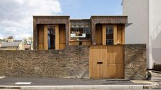 """An existing brick wall, which Satish Jassal Architects describe as """"intrinsically part of the place"""", was retained and encloses the site. Timber Ceiling, Timber Windows, London Townhouse, London House, British Architecture, Three Bedroom House, House Elevation, House Extensions, Brickwork"""