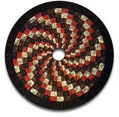 Create a quick spiral quilt with metallic thread for a pretty Christmas tree skirt this holiday. Making quilts without corners is easier than you think!