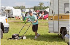 With four Big Valley Jamborees already under his belt, Justin Connolly, 23, from Red Deer, Alta. knew to bring a lawn mower for his campsite during the first day of Big Valley Jamboree in Camrose, Alta. on August 1, 2013.