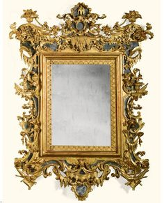 An Italian carved giltwood mirror, Venetian, circa 1730 with a shaped cresting with stylised fountain, scrolls, trelliswork, fruit-filled baskets and lambrequins, with a later rectangular plate within a lambrequin border with mirrored sides and apron, the whole carved with lambrequins, military trophies, drapery, vases and acanthus 188cm. high., 140cm. wide; 6ft. 2in., 4ft. 7in.
