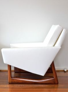 Fabulous 70s Retro Chair Designs You Must Have : Adorable White Upholstered Retro 70s Chair Design Inspiration with Glossy Wood Legs and Comfortable Backrest