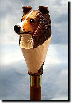 Shetland Sheepdog Walking Stick. Be the envy of everyone with this unique canine walking stick. The Shetland Sheepdog Walking Stick is a reproduction of an original woodcarving by Michael Park, a Master woodcarver, recognized worldwide for his detailed carvings and reproductions. Michael's passion and love for dogs are evident in his outstanding workmanship.