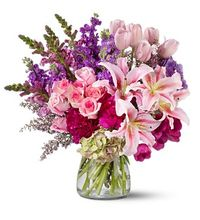 """""""Royal Radiance"""".  Make an impression with a big, dramatic bouquet of roses, peonies, lilies, tulips and more, in radiant shades of pink and purple.  http://www.allensflowermarketonline.com/royal-radiance/"""