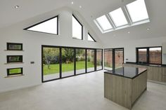 a large extension to a bungalow, to accommodate an open plan kitchen and entertaining space. Bespoke aluminium windows were used to maximize light and to frame views onto the garden House Extension Plans, House Extension Design, Extension Ideas, Bungalow Extensions, House Extensions, Roof Design, House Design, Bungalow Conversion, Bungalow Haus Design