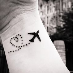 airplane tattoo, travel tattoo, airplane tattoo with heart jet stream