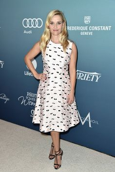 Reese Witherspoon wears a floral shift dress with strappy heels