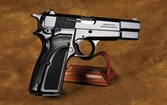 The incredibly elegant yet highly reliable Browning Hipower. Survival Weapons, Weapons Guns, Guns And Ammo, Survival Gear, Revolver Pistol, Revolvers, Mens Toys, Shooting Gear, Military Guns