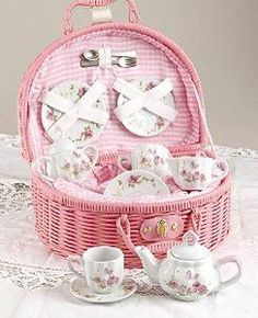 Lovely porcelain ceramic tea set daintily presented in fabric lined basket. Beautiful and fun, whether you are hosting a tea party or just playing kitchen. Pink Butterfly design with pink gingham fabr