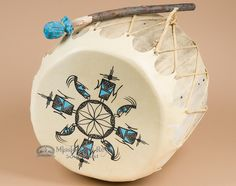 This is an authentic Native American Pueblo Indian painted ceremonial drum with genuine cowhide heads and lacing, and a strong hollowed tree trunk drum ring.