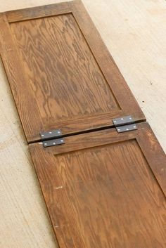 A woman connects 2 old cabinet doors. What they become? I am so stealing this for my front porch!