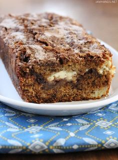 Here we have it, our family favorite banana bread. Not just any banana bread, mind you. Banana Bread with a sweet cinnamon swirl and cream cheese filling.  I've made this a few times now and it has tu