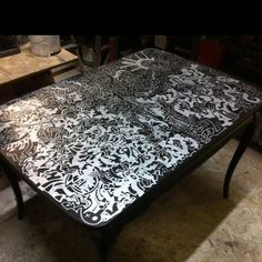 The current status of my DIY dining room table. Graffiti bombed with silver sharpie on flat black.
