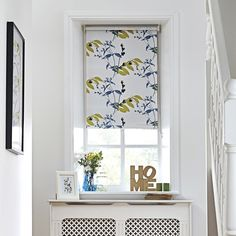 A roller blind with a bold design can bring colour and pattern to an understated area. For a neat finish, fit a cleat or tensioner at the side to secure the operating cord or chain. Find more tips at housebeautiful.co.uk