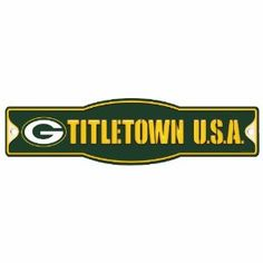 """NFL Green Bay Packers 4.5-by-17 Sign """"Titletown""""  """"Officially licensed decor signs. Uniquely shaped signs that are produced of durable plastic with die cut hanging hole(s). These signs work well as replacement to a poster because they are nearly indestructible in normal use, and can be washed with soap and water. They work great in outside or indoor applications, and are perfect to hang on doors. Made in USA.""""  Available for $13.00 with Free shipping! Green Packers, Nfl Green Bay, Green Bay Packers Merchandise, Lawn And Garden, Cincinnati, Chevrolet Logo, Fans, 17 Black, Nba"""
