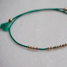 Little friendship bracelet with round balls. This one will make anyone happy!