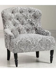 tufted arm chair $399.  In another colour to match that fancy couch :)