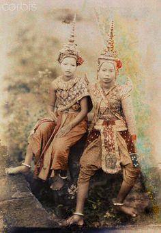 ca. July 1927, Angkor Thom, Cambodia, French Indochina    Two Cambodian dancers pose for a portrait at the Palace du Baphuon --- Image by © Gervais Courtellemont/National Geographic Society/Corbis