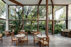 Patom Organic Living by NITAPROW Architects | Gridded glazing frames garden views from NitaProw's organic beauty shop in Bangkok | wood, glass