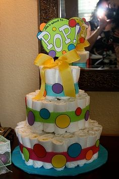 ready to pop diaper cake, also bubbles is a good one to add to this theme for decor