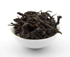 """IRON MAN: DEEP, RICH FLAVOR with GENTLE FLORAL AROMA: Reserved for the imperial families ever since the Tang dynasty, the Iron Man is a rare Oolong which grows on the cliffs of the ethereal Wu Yi Mountain. Comes with a delicate but subtle """"mineral taste"""" that's unique to the Wu Yi Cliff tea family."""