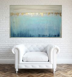 This is an original one of a kind acrylic abstract painting on gallery wrapped canvas with no visible staples by Ora Birenbaum.  Gorgeous modern piece with shades of white, cream, and taupe for the top section and white, sea foam, dusty blue, and cadet blue with periwinkle and rich navy for the lower portion. There is an edging of taupe around the painting and touches of metallic pewter and gold for a touch of shimmer. Lovely soft hues with beautiful depth.  This painting is very neutral and…