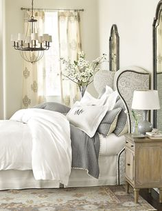 A winged headboard brings a luxurious feel to this charming bedroom