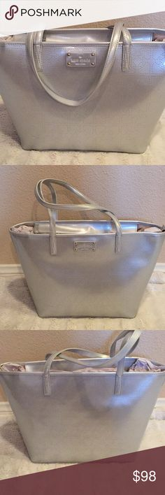 NWOT Pearl Grey Kate Spade Tote🌟 Beautiful NWOT pearl grey Kate Spade Tote, in perfect condition, new never used my baby pulled of the tag. This bag has lots of room and can be used for many occasions, it measures 16 inches wide and 11 inches tall, thanks for looking 😊 kate spade Bags Totes