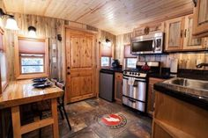 The caboose train car you see below was renovated into the beautiful caboose tiny house that it is today. Pretty cool, right? It's called the Great Northern X215 and is available as one of many cab...