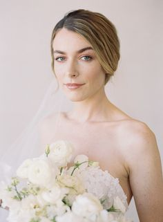 Floral Centerpieces Stand Out Amidst Neutral Palette of Whites, Ivory, and Gold in Elegant Bridal Editorial #organicweddings #minimalistweddings #elegantbridalstyle #elegantbrides  #bridaleditorial