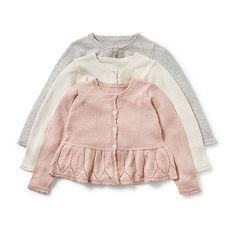 A lovely fine knit cardigan with wide flounce and glittery threads.  <em>The price above refers to one item.</em>