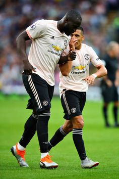 Alexis Sanchez of Manchester United talks with teammate Romelu Lukaku during the Premier League match between Burnley FC and Manchester United at Turf Moor on September 2018 in Burnley, United. Alexis Sanchez, Burnley Fc, Manchester United Players, Premier League Matches, Gareth Bale, Cristiano Ronaldo, The Unit, Victoria Justice, Sports