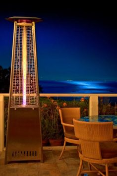 """An answer to the ubiquitous """"mushroom"""" outdoor heaters, Lava recently introduced their pyramid-shaped heaters to the States. The big advantage, other than its striking European-designed… Outdoor Heaters Patio, Patio Heater, Outdoor Spaces, Outdoor Living, Backyard Patio, Exterior, Landscape, Hunting, Design"""
