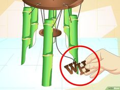 How to Make a Bamboo Wind Chime (with Pictures) - wikiHow Bamboo Wind Chimes, Wind Chimes Craft, Carillons Diy, Wood Phone Stand, Bamboo Trellis, Indoor Crafts, Blue Living Room Decor, Bamboo Canes, Bamboo Furniture
