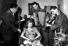 SS musicians play to Eva Braun at her sister's wedding. Courtesy CSU Archives/Everett Collection