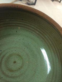 From FB Ceramic Recipes  Nancy Gallagher updated the group photo. September 21 at 11:51am · Seven Valleys, PA · Edited  Sage Green Breaking Brown  Cone 6 oxidation Had to come up with a green for a dinnerware set. Based on Odyssey base glaze - cone 6.  Mixes up and goes on nicely, and inexpensive to mix.  20 Gerstley Borate 10 Calcium Carbonate 30 Neph Sy 10 EPK 30 Silica 1 Chrome Oxide 2 Titanium Dioxide 2 Rutile  Sample shown on Highwater Redrock.  Fast glaze to cone 6 and off.