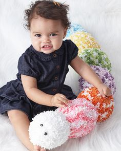 It's easy to crochet this plush and comfy caterpillar toy in the rainbow of shades from Bernat Tizzy!