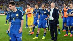 A dejected Lionel Messi of Argentina looks on with his team Monday, 14 July 2014