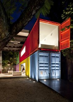 Decameron / Marcio Kogan. Neon shipping containers in the Sao Paulo store Decameron. By Studio MK27