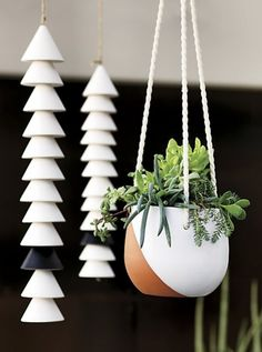 sight and sound. Earthy stoneware cones shape a symbiotic sway of sound and motion. Ceramic matte white chimes make way for one opposite in striking matte black. Visual interest stacks up with 12 chimes suspended from a single jute cord. Natural elegance at its most refined.