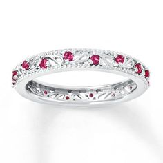 This stackable ring is decorated with diamonds and lab-created rubies on a wave design band. The sterling silver band has a total diamond weight of carat. Diamond Total Carat Weight may range from - carats. Fashion Rings, Fashion Jewelry, Stackable Rings, Eternity Bands, Diamond Gemstone, Band Rings, Sterling Silver Jewelry, Vintage Jewelry, Wedding Rings