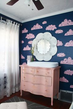 Navy & Pink Nursery with custom cloud decals. They were designed by the mother's friend and cut out on her silhouette machine.