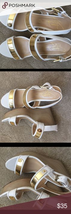 White and gold wedge heels size 8 White and gold wedge heels size 8. Worn once. Great condition. The wooden heel is really cute Report Signature Shoes Heels