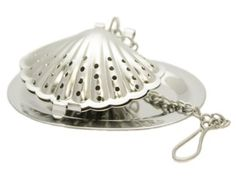 Sea Shell Stainless Steel Tea Infuser with Drip Tray by SCI Scandicrafts, http://www.amazon.com/dp/B002UC9IWM/ref=cm_sw_r_pi_dp_NFaMqb1VYAADP
